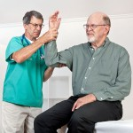 a rheumatologist checking a painful elbow