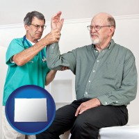 co a rheumatologist checking a painful elbow
